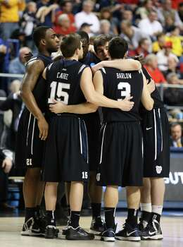 LEXINGTON, KY - MARCH 23: The Butler Bulldogs huddle in the first half against the Marquette Golden Eagles during the third round of the 2013 NCAA Men's Basketball Tournament at Rupp Arena on March 23, 2013 in Lexington, Kentucky. Photo: Andy Lyons, Getty Images / 2013 Getty Images