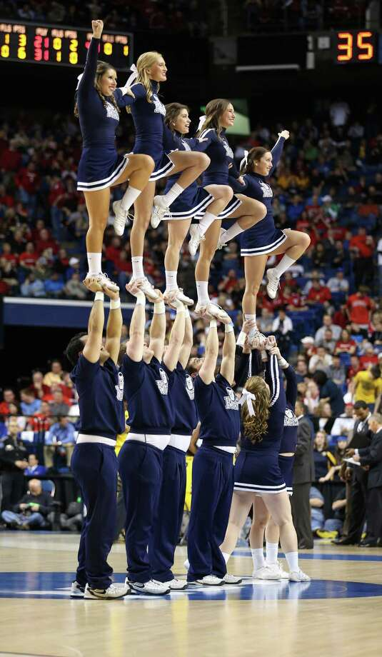 LEXINGTON, KY - MARCH 23:  The Butler Bulldogs cheerleaders perform on the court during a game stoppage in the first half against the Marquette Golden Eagles during the third round of the 2013 NCAA Men's Basketball Tournament at Rupp Arena on March 23, 2013 in Lexington, Kentucky. Photo: Andy Lyons, Getty Images / 2013 Getty Images