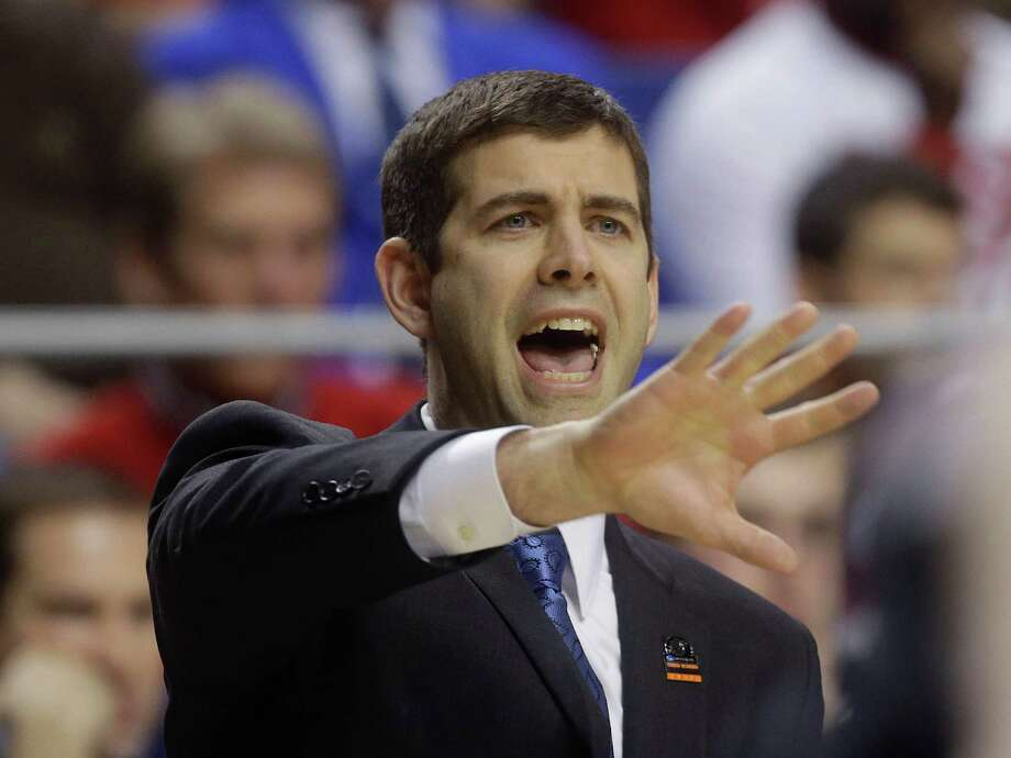 Butler head caoch Brad Stevens reacts in the first half of a third-round NCAA college basketball tournament game against Marquette, Saturday, March 23, 2013, in Lexington, Ky.  (AP Photo/John Bazemore) Photo: John Bazemore, Associated Press / AP