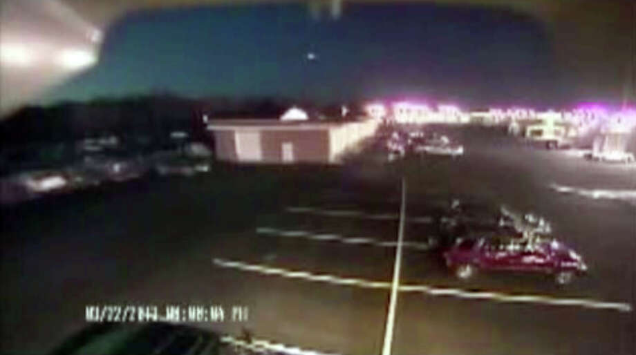 "In this image taken from video provided by Tom Hopkins of Hopkins Automotive Group, a bright flash of light, top center, streaks across the early-evening sky in what experts say was almost certainly a meteor coming down, Friday, March 22, 2013 in Seaford, Del. Bill Cooke of NASA's Meteoroid Environmental Office said the flash appears to be ""a single meteor event."" He said it ""looks to be a fireball that moved roughly toward the southeast, going on visual reports."" (AP Photo/Hopkins Automotive Group) MANDATORY CREDIT: HOPKINS AUTOMOTIVE GROUP Photo: Uncredited"