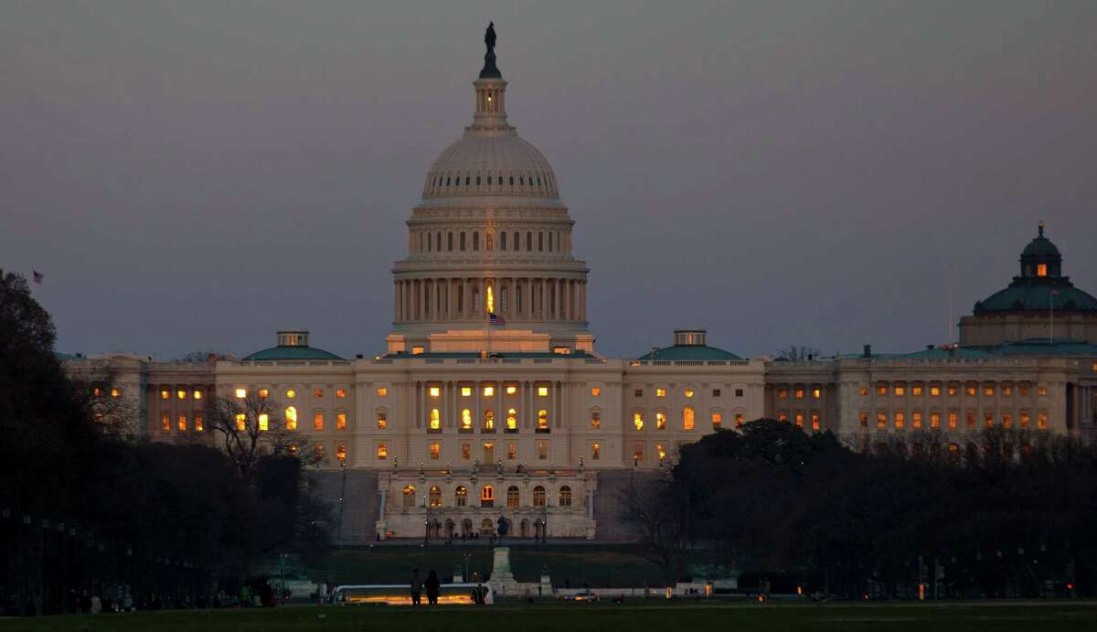 The setting sun is reflected in the windows of the U.S. Capitol, on Capitol Hill, Friday, March 22, 2013 in Washington. (AP Photo/Alex Brandon)