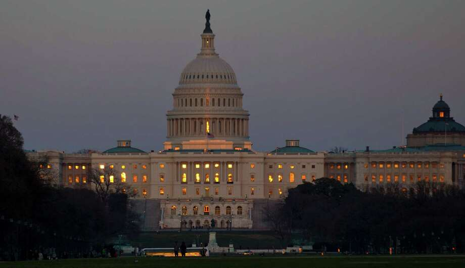 The setting sun is reflected in the windows of the U.S. Capitol, on Capitol Hill, Friday, March 22, 2013 in Washington. (AP Photo/Alex Brandon) Photo: Alex Brandon