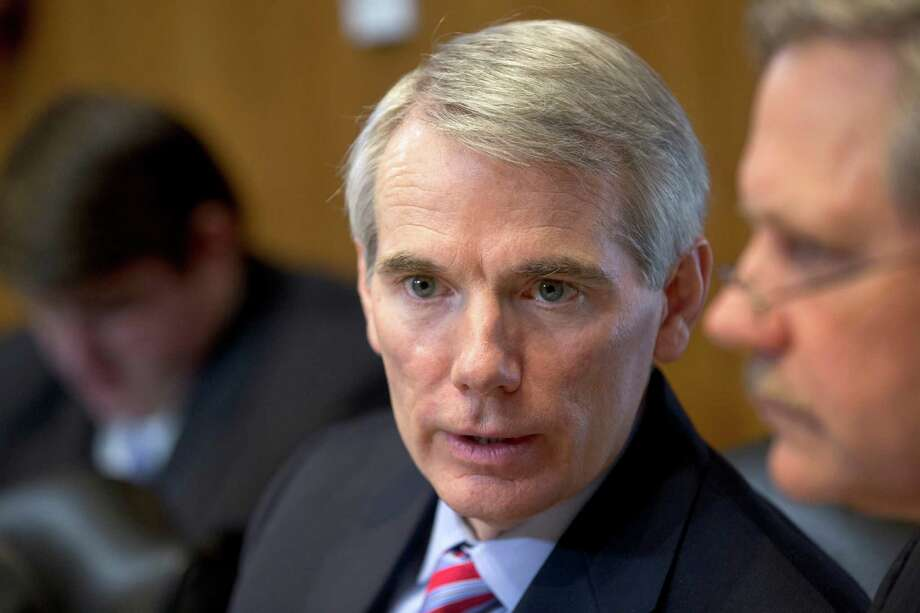 Senate Energy Committee member Sen. Rob Portman, R-Ohio, sits in on the committee's discussion on the nomination of Sally Jewell to be secretary of the Interior, Thursday, March 21, 2013, on Capitol Hill in Washington. Last week Portman announced he is supporting gay marriage and says his reversal on the issue began when he learned one of his sons is gay.  (AP Photo/J. Scott Applewhite) Photo: J. Scott Applewhite