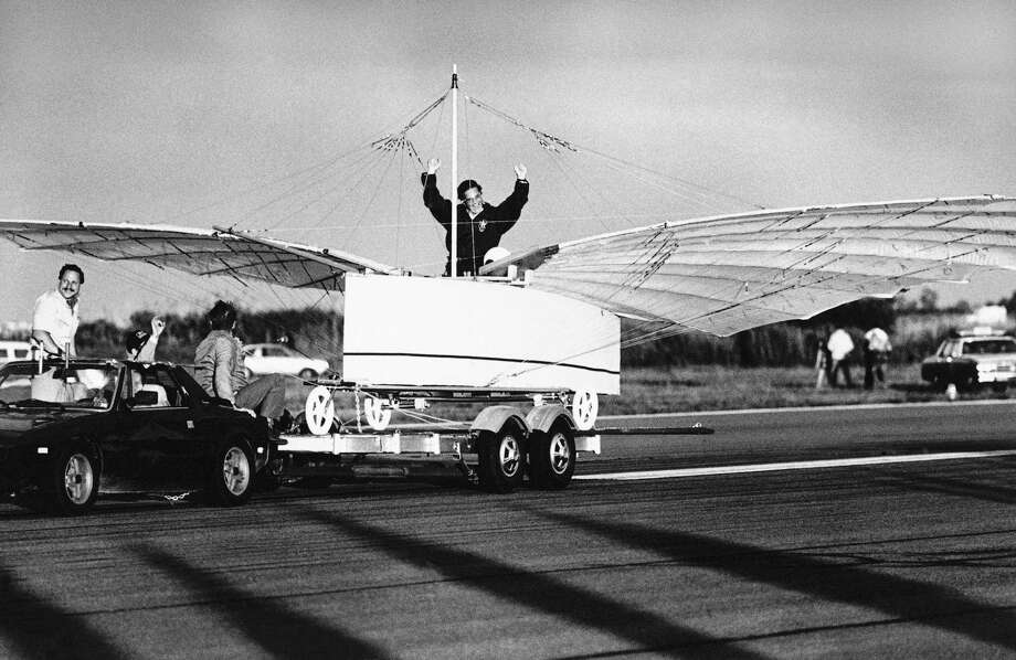 Actor Cliff Robertson signals success after he test-piloted a replica of an airplane challenging the Wright brothers' status as the first to fly on Friday morning, July 11, 1986 in a tethered test flight at Sikorsky Memorial Airport in Stratford, Conn.  The aircraft, in the test flight, rose off the trailer  while being towed.  Its builders want to prove that Gustave Whitehead a Connecticut Aviation pioneer, flew in 1901. (AP Photo/Peter Hvizdak) Photo: Peter Hvizdak, ASSOCIATED PRESS / AP1986