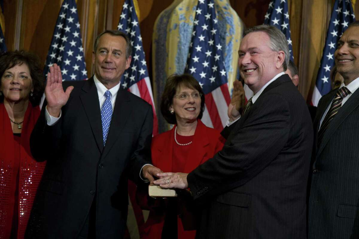 Rep. Steve Stockman, R-Friendswood, participates in a mock swearing-in ceremony with House Speaker John Boehner, R-Ohio, for the 113th Congress this year.