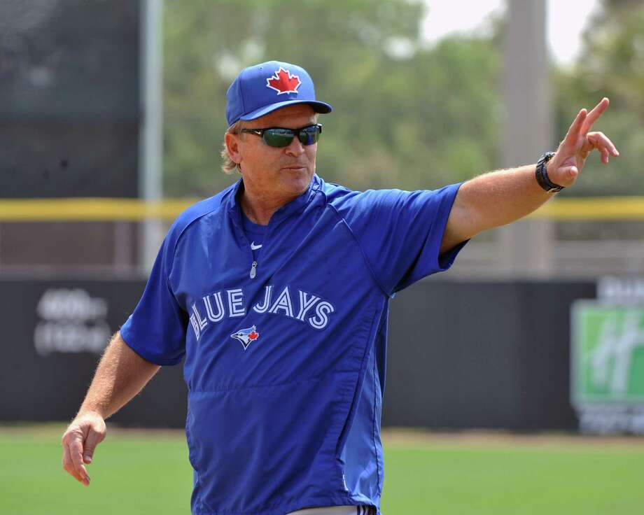 Blue Jays manager John Gibbons, a MacArthur grad, waves to fans before Saturday's spring training game against the Braves in Dunedin, Fla. Photo: Al Messerschmidt / Getty Images