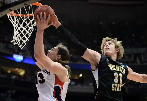 SALT LAKE CITY, UT - MARCH 23:  Kelly Olynyk #13 of the Gonzaga Bulldogs has his shot blocked by Ron Baker #31 of the Wichita State Shockers in the second half during the third round of the 2013 NCAA Men's Basketball Tournament at EnergySolutions Arena on March 23, 2013 in Salt Lake City, Utah. Photo: Harry How, Getty Images / 2013 Getty Images