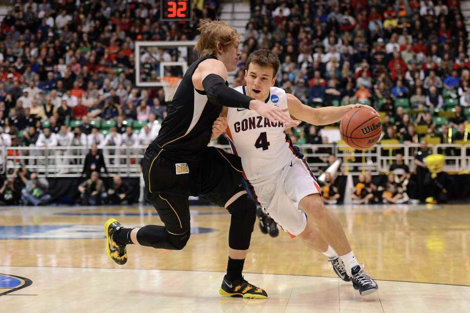 SALT LAKE CITY, UT - MARCH 23:  Kevin Pangos #4 of the Gonzaga Bulldogs drives on Ron Baker #31 of the Wichita State Shockers in the second half during the third round of the 2013 NCAA Men's Basketball Tournament at EnergySolutions Arena on March 23, 2013 in Salt Lake City, Utah. Photo: Harry How, Getty Images / 2013 Getty Images