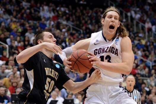 SALT LAKE CITY, UT - MARCH 23:  Kelly Olynyk #13 of the Gonzaga Bulldogs with the ball against Jake White #50 of the Wichita State Shockers in the second half during the third round of the 2013 NCAA Men's Basketball Tournament at EnergySolutions Arena on March 23, 2013 in Salt Lake City, Utah. Photo: Harry How, Getty Images / 2013 Getty Images