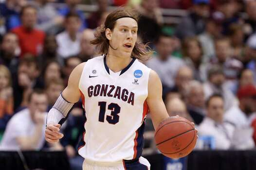SALT LAKE CITY, UT - MARCH 23:  Kelly Olynyk #13 of the Gonzaga Bulldogs moves the ball in the first half while taking on the Wichita State Shockers during the third round of the 2013 NCAA Men's Basketball Tournament at EnergySolutions Arena on March 23, 2013 in Salt Lake City, Utah. Photo: Streeter Lecka, Getty Images / 2013 Getty Images
