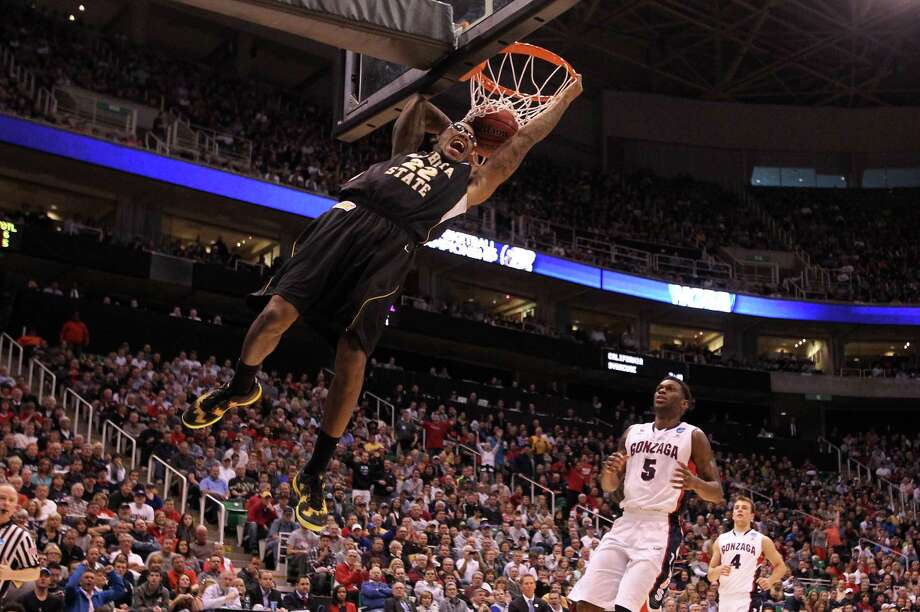 SALT LAKE CITY, UT - MARCH 23:  Carl Hall #22 of the Wichita State Shockers dunks the ball in the first half while taking on the Gonzaga Bulldogs during the third round of the 2013 NCAA Men's Basketball Tournament at EnergySolutions Arena on March 23, 2013 in Salt Lake City, Utah. Photo: Streeter Lecka, Getty Images / 2013 Getty Images