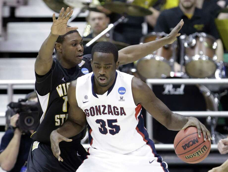 Wichita State's Cleanthony Early (11) guards Gonzaga's Sam Dower (35) in the first half during a third-round game in the NCAA men's college basketball tournament in Salt Lake City on Saturday, March 23, 2013. (AP Photo/Rick Bowmer) Photo: Rick Bowmer, Associated Press / AP