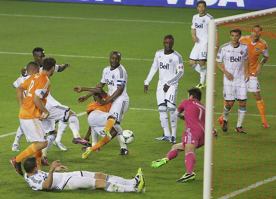Dynamo defender Warren Creavalle finishes the go-ahead goal against the Whitecaps. Photo: James Nielsen, Houston Chronicle / © 2013 Houston Chronicle