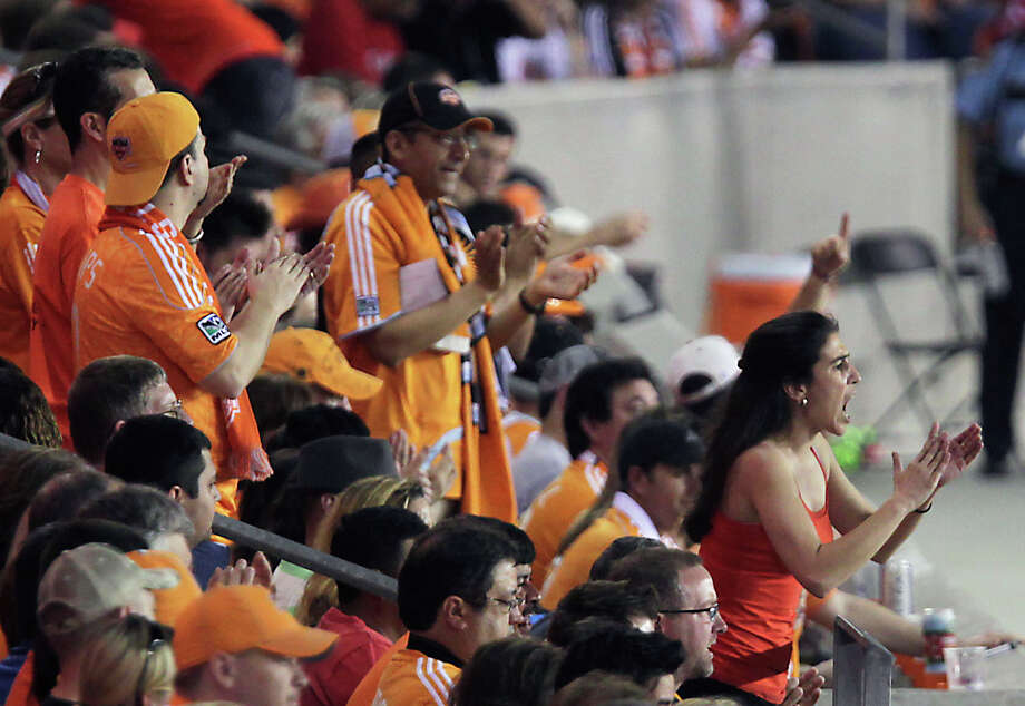 Houston Dynamo fans cheer during the second half of MLS game action the Vancouver Whitecaps at BBVA Compass Stadium Saturday, March 23, 2013, in Houston . Photo: James Nielsen, Houston Chronicle / © 2013 Houston Chronicle