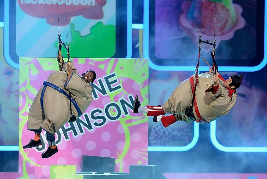 TV personality Nick Cannon and host Josh Duhamel perform onstage during Nickelodeon's 26th Annual Kids' Choice Awards at USC Galen Center on March 23, 2013 in Los Angeles, California.  (Photo by Kevork Djansezian/Getty Images for KCA) Photo: Kevork Djansezian, Getty Images For KCA