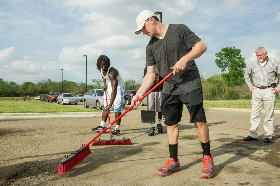 QB Johnny Manziel and Michael Richardson (left) put some finishing touches on the Twin City Mission playground the A&M team built in Bryan. Photo: Glen Johnson / Texas A&M