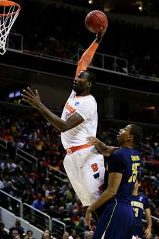 Syracuse 66, California 60SAN JOSE, CA - MARCH 23:  Baye Keita #12 of the Syracuse Orange goes up over Richard Solomon #35 of the California Golden Bears in the first half during the third round of the 2013 NCAA Men's Basketball Tournament at HP Pavilion on March 23, 2013 in San Jose, California. Photo: Ezra Shaw, Getty Images / 2013 Getty Images