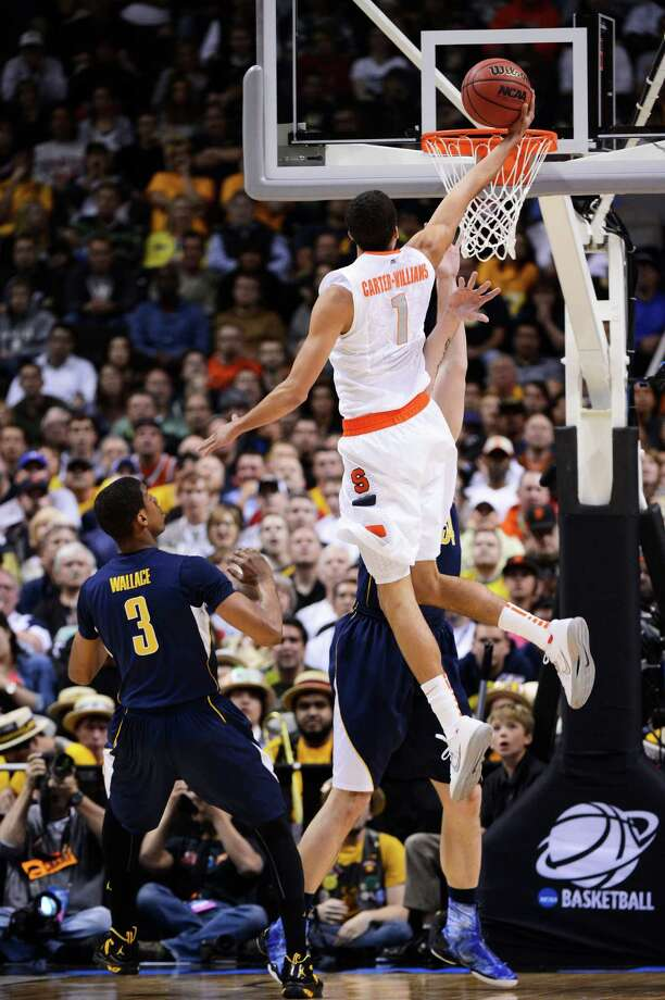 SAN JOSE, CA - MARCH 23:  Michael Carter-Williams #1 of the Syracuse Orange shoots a layup over Tyrone Wallace #3 of the California Golden Bears in the first half during the third round of the 2013 NCAA Men's Basketball Tournament at HP Pavilion on March 23, 2013 in San Jose, California. Photo: Thearon W. Henderson, Getty Images / 2013 Getty Images