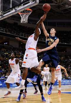 SAN JOSE, CA - MARCH 23:  C.J. Fair #5 of the Syracuse Orange is fouled by David Kravish #45 of the California Golden Bears during the third round of the 2013 NCAA Men's Basketball Tournament at HP Pavilion on March 23, 2013 in San Jose, California. Photo: Thearon W. Henderson, Getty Images / 2013 Getty Images