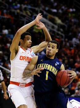 SAN JOSE, CA - MARCH 23:  Justin Cobbs #1 of the California Golden Bears drives against Michael Carter-Williams #1 of the Syracuse Orange during the third round of the 2013 NCAA Men's Basketball Tournament at HP Pavilion on March 23, 2013 in San Jose, California. Photo: Ezra Shaw, Getty Images / 2013 Getty Images