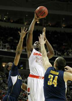Syracuse forward Rakeem Christmas (25) drives to the basket against California guard Tyrone Wallace (3) and forward Robert Thurman (34) during the first half of a third-round game in the NCAA college basketball tournament Saturday, March 23, 2013, in San Jose, Calif.  (AP Photo/Tony Avelar) Photo: Tony Avelar, Associated Press / FR155217 AP