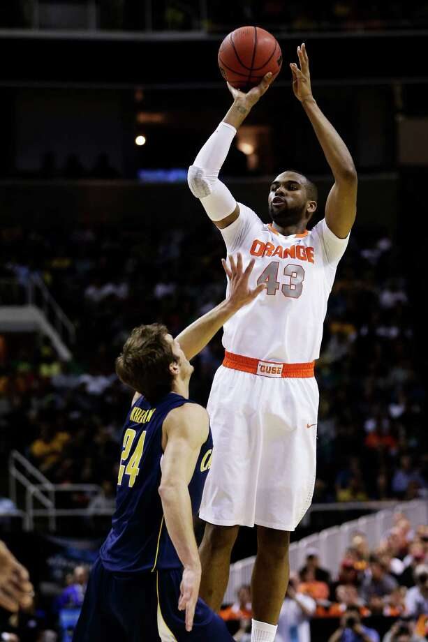 SAN JOSE, CA - MARCH 23:  James Southerland #43 of the Syracuse Orange shoots over Ricky Kreklow #24 of the California Golden Bears in the first half during the third round of the 2013 NCAA Men's Basketball Tournament at HP Pavilion on March 23, 2013 in San Jose, California. Photo: Ezra Shaw, Getty Images / 2013 Getty Images