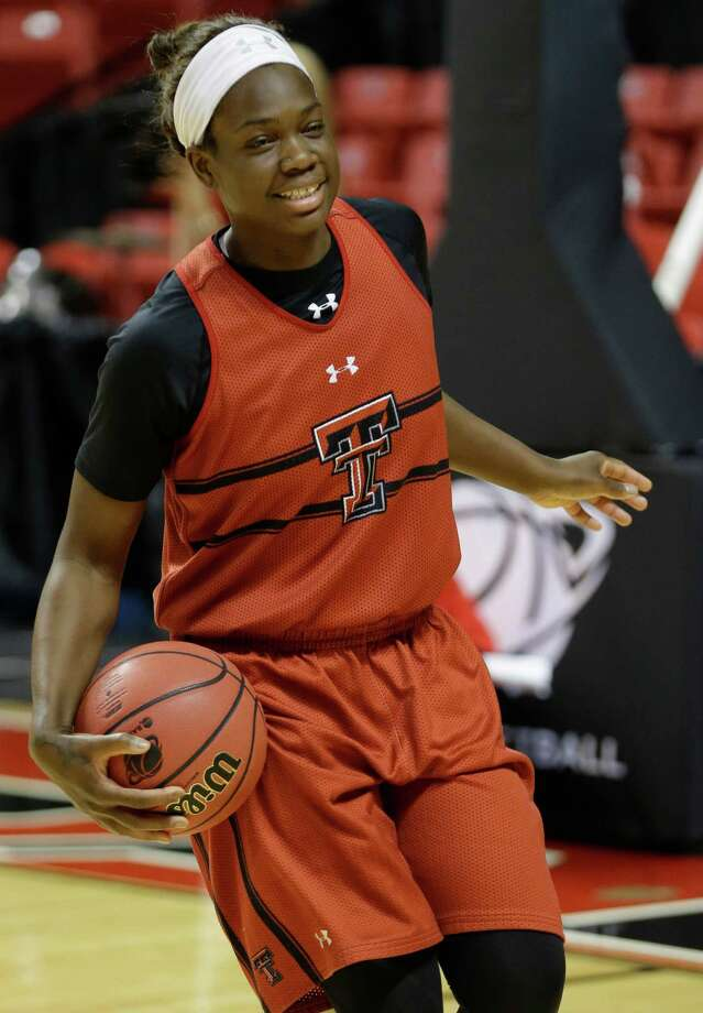 Texas Tech guard Christine Hyde smiles during a drill for team practice for a first-round game in the women's NCAA college basketball tournament in Lubbock, Texas, Friday, March 22, 2013. Texas Tech is to play South Florida on Saturday. (AP Photo/LM Otero) Photo: LM Otero, STF / AP