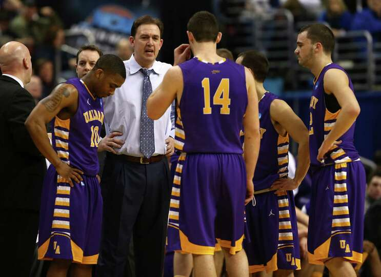 PHILADELPHIA, PA - MARCH 22:  Head coach Will Brown of the Albany Great Danes talks to his team in t