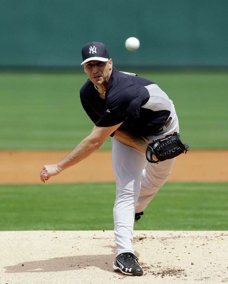New York Yankees starting pitcher Andy Pettitte throws during the first inning of an exhibition spring training baseball game against the Detroit Tigers, Saturday, March 23, 2013 in Lakeland, Fla. (AP Photo/Carlos Osorio) Photo: Carlos Osorio