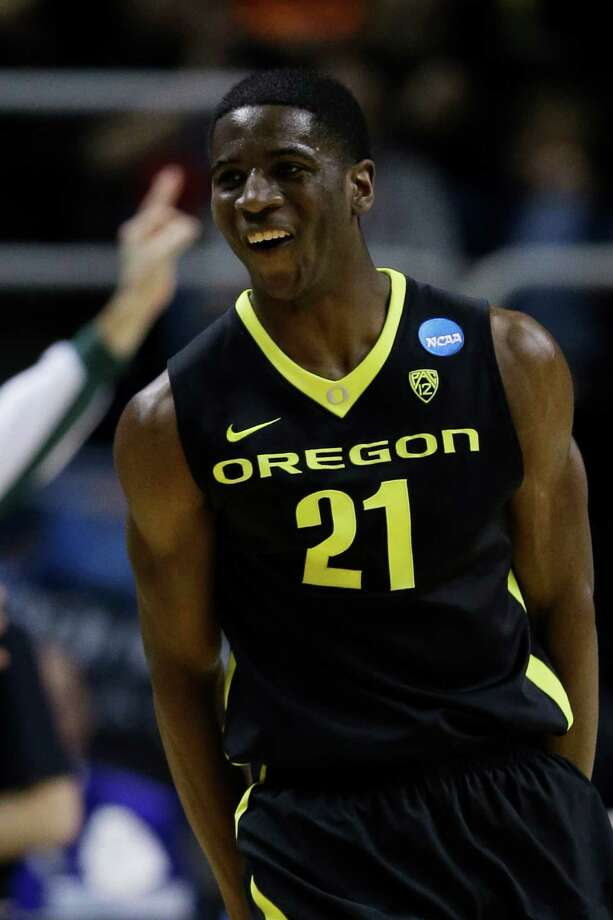 SAN JOSE, CA - MARCH 23:  Damyean Dotson #21 of the Oregon Ducks celebrates after scoring a second half three-pointer against the Saint Louis Billikens during the third round of the 2013 NCAA Men's Basketball Tournament at HP Pavilion on March 23, 2013 in San Jose, California.  (Photo by Ezra Shaw/Getty Images) Photo: Ezra Shaw