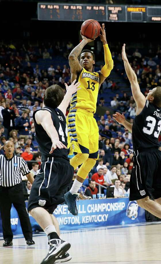 LEXINGTON, KY - MARCH 23: Vander Blue #13 of the Marquette Golden Eagles shoots against Andrew Smith #44 and Chase Stigall #33 of the Butler Bulldogs in the second half during the third round of the 2013 NCAA Men's Basketball Tournament at Rupp Arena on March 23, 2013 in Lexington, Kentucky.  (Photo by Kevin C. Cox/Getty Images) Photo: Kevin C. Cox
