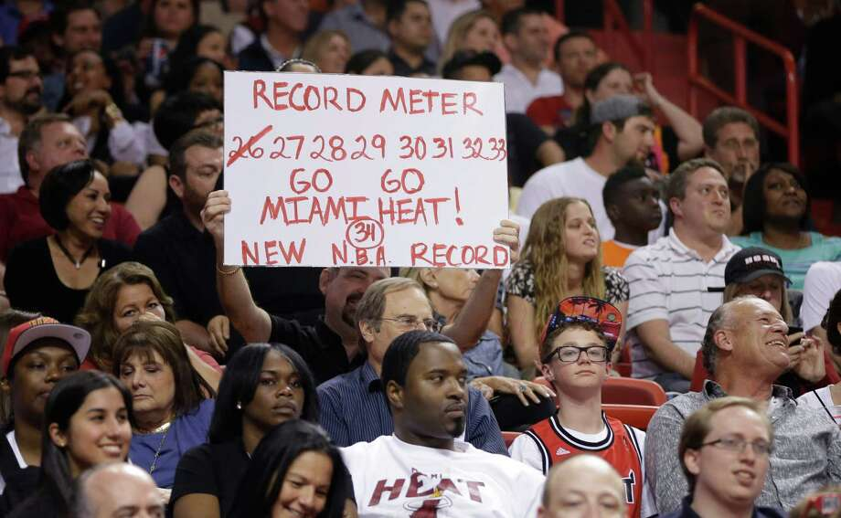 A Miami Heat fan displays a sign about the MiamI Heat's winning streak during the second half of a NBA basketball game in Miami, Friday, March 22, 2013 against the Detroit Pistons. The Heat won 103-89. (AP Photo/J Pat Carter) Photo: J Pat Carter