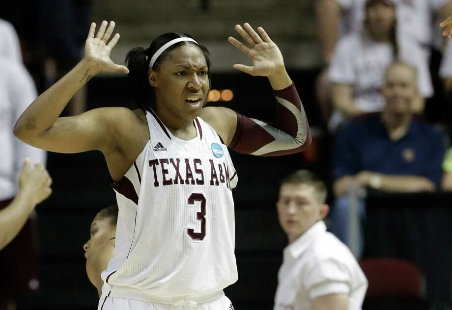 Texas A&M's Kelsey Bone raises her arms during a first-round game against Wichita State in the women's NCAA college basketball tournament in College Station, Texas, Saturday, March 23, 2013. (AP Photo/Pat Sullivan) Photo: Pat Sullivan, Associated Press / AP