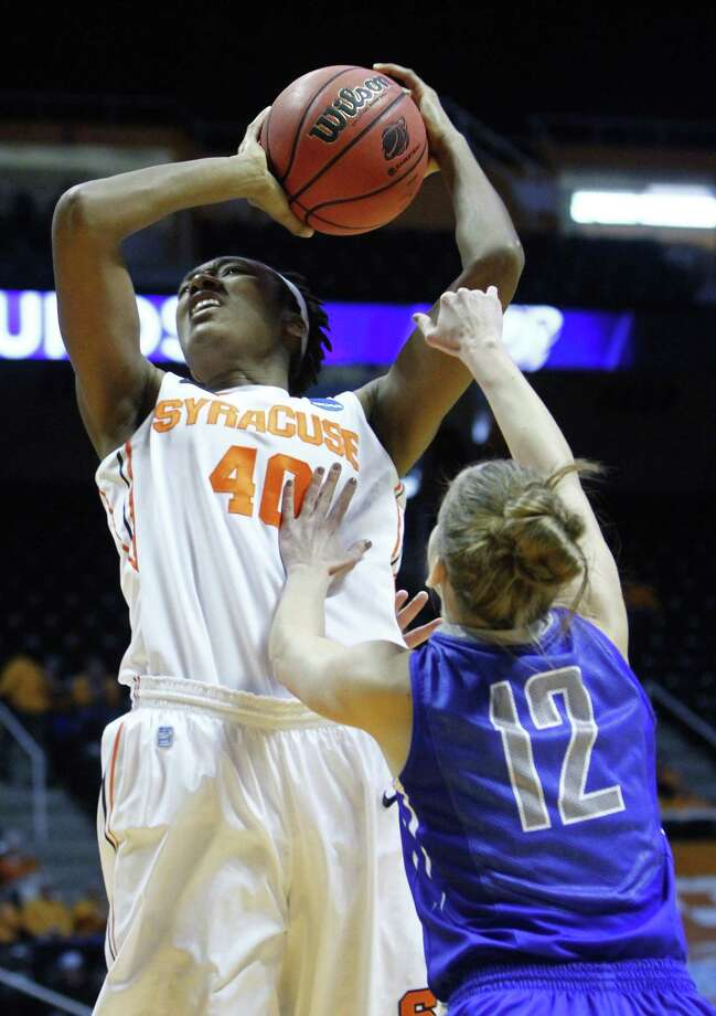 Syracuse center Kayla Alexander (40) goes for a shot as she's fouled by Creighton guard Ally Jensen (12) in the first half of a first-round game in the women's NCAA college basketball tournament on Saturday, March 23, 2013, in Knoxville, Tenn. (AP Photo/Wade Payne) Photo: Wade Payne