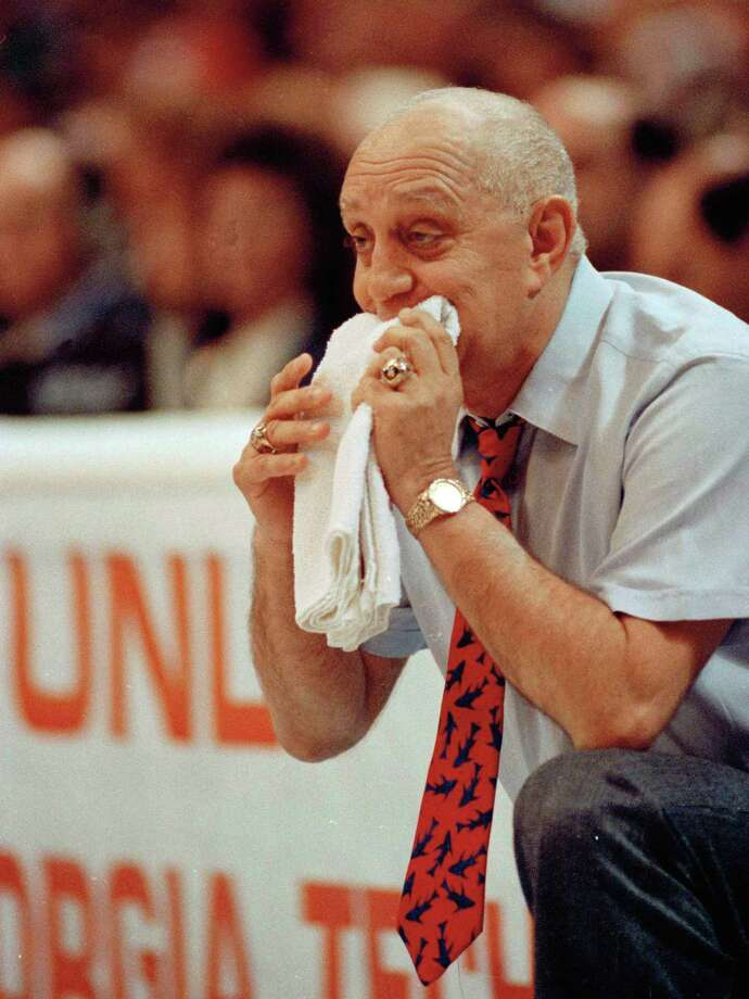 FILE - In this April 2, 1990, file phot, UNLV coach Jerry Tarkanian chews on his towel while watching his Runnin' Rebels run over Duke University in the championship game of the Final Four in Denver. Tarkanian was in his element last weekend, watching UNLV from a courtside seat in the venue he helped build. As the NCAA tournament continues, the only question left about Tarkanian's legacy is why he's not in the Hall of Fame.  (AP Photo/Ed Reinke, File) Photo: Ed Reinke