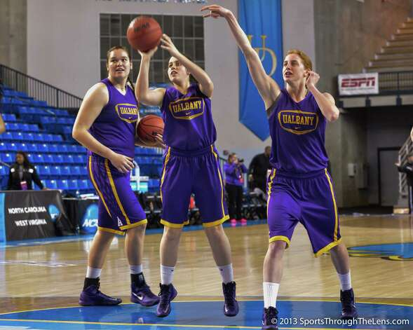 UAlbany players (from left) Megan Craig, Lindsey Lowrie and Julie Forster practice at Bob Carpenter Center on the University of Delaware campus on Saturday, March 23, 2013, the day before their NCAA Tournament game against North Carolina. (Gregory Fisher / SportsThroughTheLens.com) Photo: Gregory J. Fisher