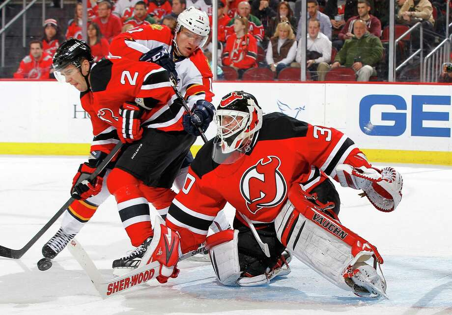 NEWARK, NJ - MARCH 23:  Martin Brodeur #30 and Marek Zidlicky #2 of the New Jersey Devils defend the net against Jonathan Huberdeau #11 of the Florida Panthers at the Prudential Center on March 23, 2013 in Newark, New Jersey.  (Photo by Jim McIsaac/Getty Images) Photo: Jim McIsaac
