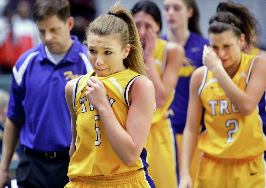 Troy's #5 Brayleigh Hanlon, center, and teammates leave the court after losing the Class A girls' Federation final to Long Island Lutheran at the Times Union Center Saturday March 23, 2013.  (John Carl D'Annibale / Times Union) Photo: John Carl D'Annibale / 00021672A
