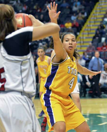 Troy's #4 Kiana Patterson, at right, covers Long Island Lutheran's #5 Kaela Hilaire during the Class