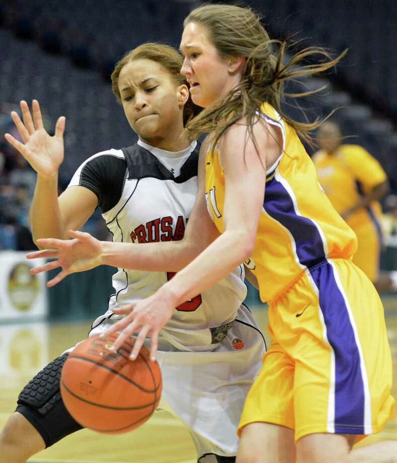 Troy's #3 Mary Pattison, at right, and Long Island Lutheran's #5 Kaela Hilaire during the Class A girls' Federation final at the Times Union Center Saturday March 23, 2013.  (John Carl D'Annibale / Times Union) Photo: John Carl D'Annibale / 00021672A