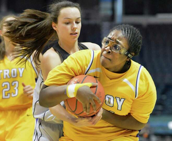 Troy's #44 Cheyenne Williams, at right, wrestles a rebound away from Long Island Lutheran's #12 Kati