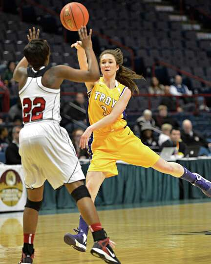 Troy's #3 Mary Pattison, at right, gets a pss by  Long Island Lutheran's #22 Staci Barrett during th