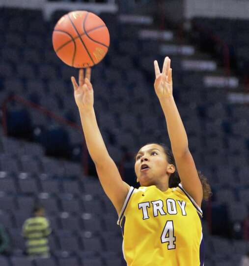 Troy's #4 Kiana Patterson sinks a three-pointer during the Class A girls' Federation final against L