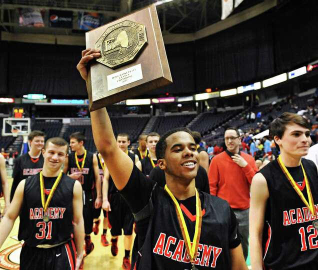 Albany Academy's #1 Darrien White with the Class A boys' Federation trophy after beating John Adams