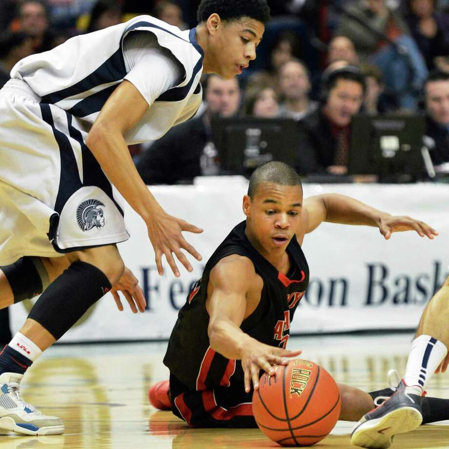 Albany Academy's #22 Ray Jerome, at right, fights John Adams' #11 Paul Johnson for a loose ball during the Class A boys' Federation final at the Times Union Center Saturday March 23, 2013. (John Carl D'Annibale / Times Union) Photo: John Carl D'Annibale / 00021671A