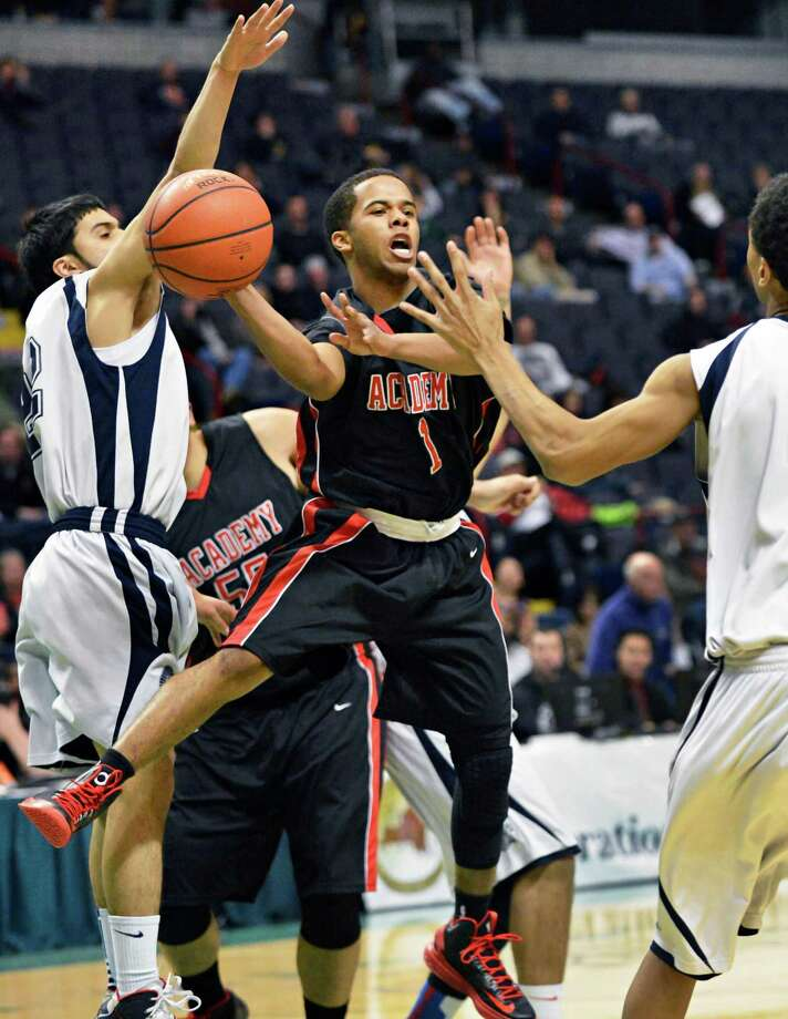 Albany Academy's #1 Darrien White gets a pass through John Adams' defenders during the Class A boys' Federation final at the Times Union Center Saturday March 23, 2013. (John Carl D'Annibale / Times Union) Photo: John Carl D'Annibale / 00021671A