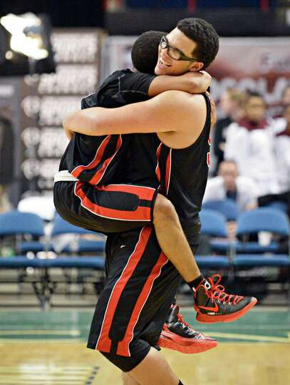 Albany Academy's Darrien White, left, and celebrate after beating John Adams in the Class A boys' Fe