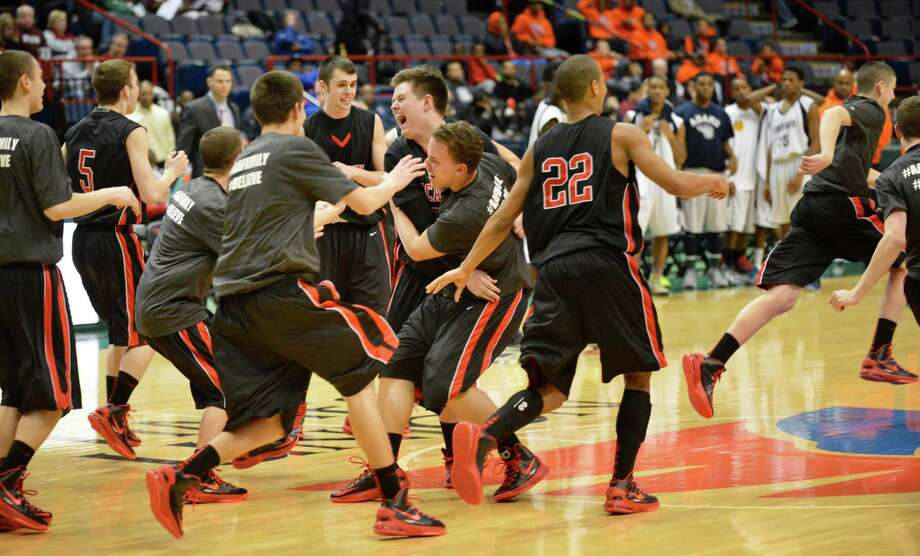 Albany Academy players celebrate after beating John Adams in the Class A boys' Federation final at the Times Union Center Saturday March 23, 2013. (John Carl D'Annibale / Times Union) Photo: John Carl D'Annibale / 00021671A