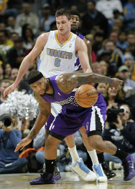 DeMarcus Cousins (front) and the Kings, who had a one-point lead heading into the fourth quarter, couldn't keep the Nuggets from their 15th straight win. Photo: David Zalubowski / Associated Press