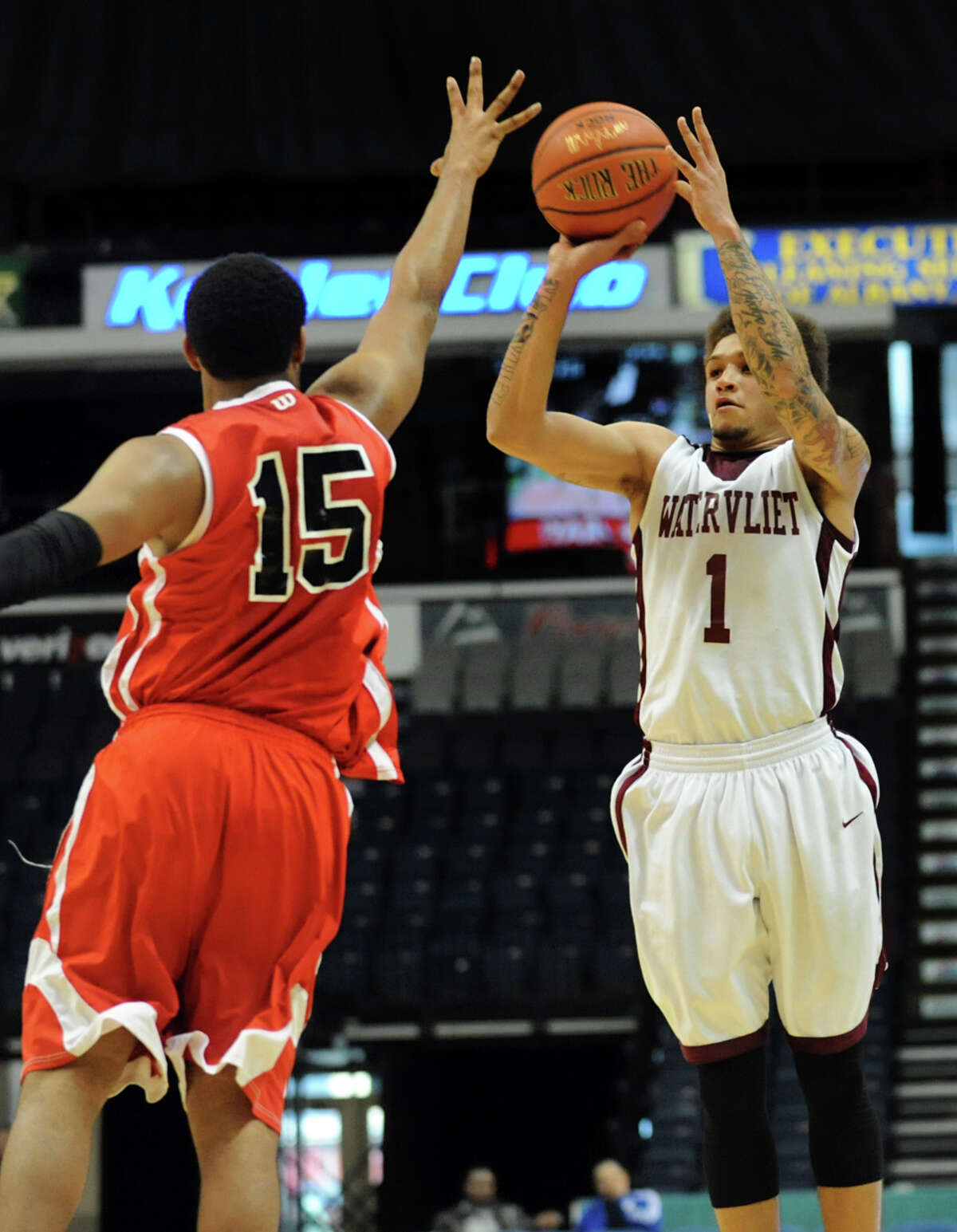 Watervliet's Jordan Gleason, left, shoots for three points as Fannie Lou Hamer's Michael Castello defends during their Class B State Federation basketball game on Saturday, March 23, 2013, at Times Union Center in Albany, N.Y. (Cindy Schultz / Times Union)